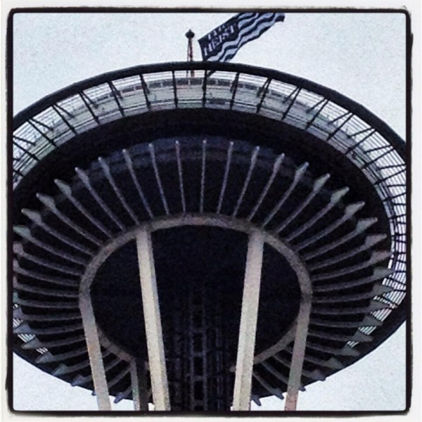 The Heist flag flying atop the Space Needle. Photo by @KarenWild